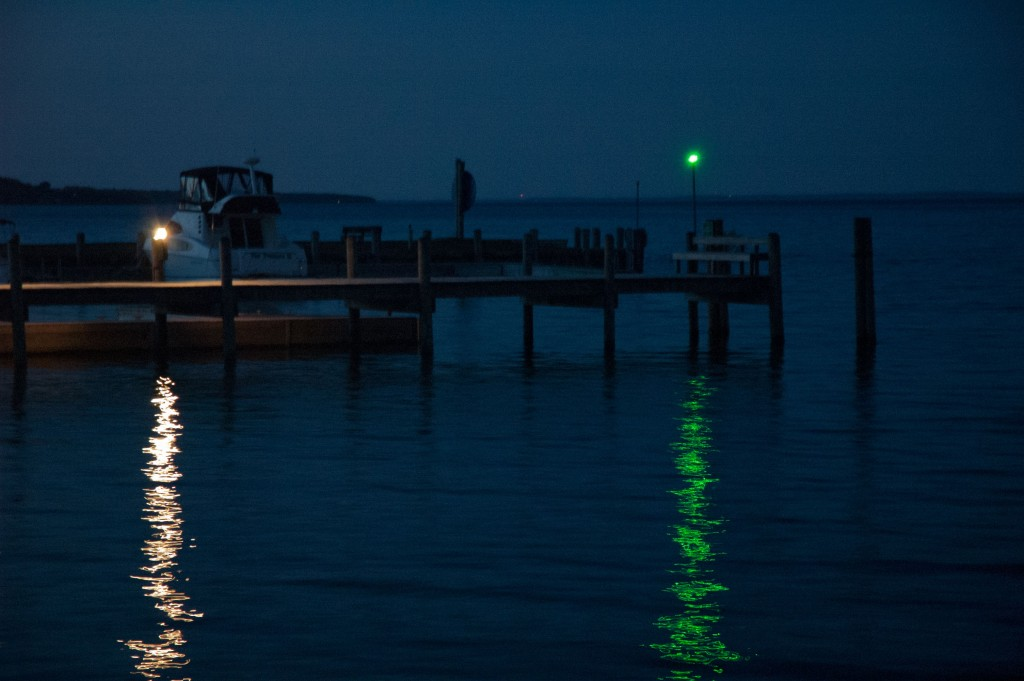 Green navigation light on water